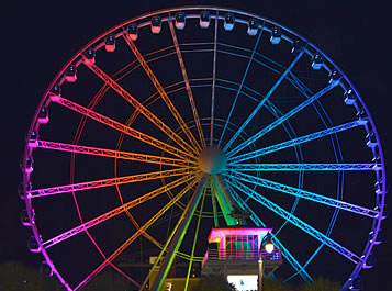 The Myrtle Beach SkyWheel at night showing all its spokes lit up.